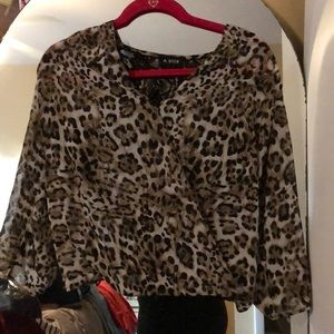 A. byer cheetah print dress top with lace back